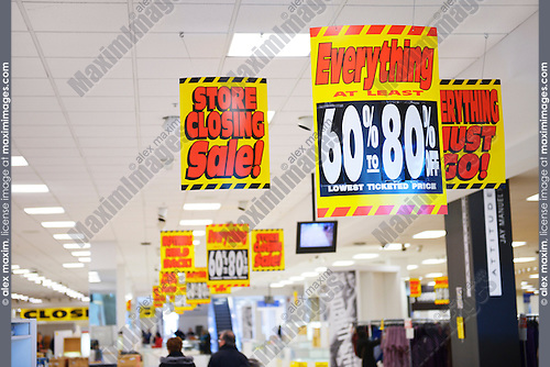 Discount signs at half empty Sears store closing sale at Yorkdale shopping center, Toronto, Ontario, Canada 2014.