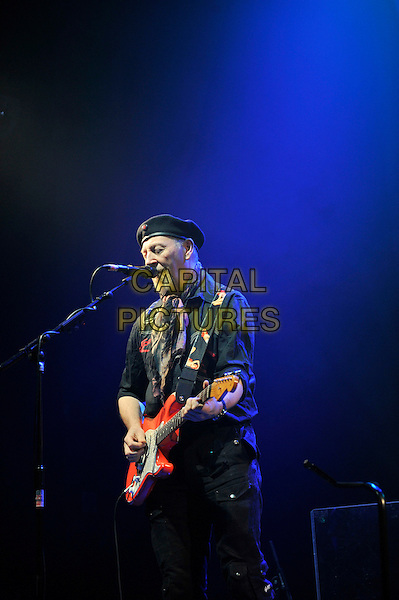Richard Thompson.performing in concert, Shepherd's Bush Empire, London, England. .25th February 2013.on stage lie gig performance music length hat flat cap scarf black shirt half singing guitar goatee facial hair .CAP/MAR.© Martin Harris/Capital Pictures.