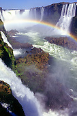 Iguassu Falls, Parana State, Brazil.  Spectacular aerial view of the waterfalls with a rainbow over them.