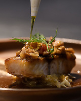 "Melbourne, July 13, 2018 - The dish of <br /> ""Wild barramundi, porcini mushroom & fennel fondue, Champagne jus"" at the Pommery Champagne Dinner at Philippe Restaurant in Melbourne, Australia. Photo Sydney Low"
