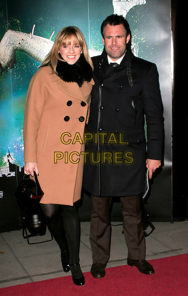 "GABBY LOGAN & KENNY LOGAN .VIP Gala Premiere of Cirque de Soleil's ""Quidam"" at the Royal Albert Hall, London, England,  January 6th 2009.Cirque de Soleil  full length brown camel tan coat husband wife couple black grey gray fur .CAP/AH.©Adam Houghton/Capital Pictures"