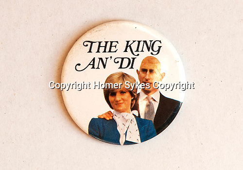 The King an' Di badge celebration of the marriage of prince Charles and Lady Diana Spencer. A play on the words &quot;The King and I &quot;from the 1956 Yul Brynner film of that title. Charles was mocked for a bald patch.<br /> <br /> July 29, 1981