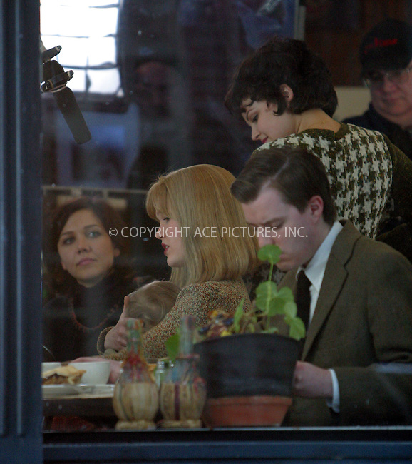 """Maggie Gyllenhaal, Julia Stiles and Ginnifer Goodwin on the set of """"Mona Lisa Smile"""" at a Greenwich Village restaurant. New York, January 13, 2003. Please byline: Alecsey Boldeskul/NY Photo Press.   ..*PAY-PER-USE*      ....NY Photo Press:  ..phone (646) 267-6913;   ..e-mail: info@nyphotopress.com"""