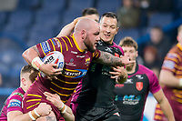 Picture by Allan McKenzie/SWpix.com - 15/03/2018 - Rugby League - Betfred Super League - Huddersfield Giants v Hull KR - John Smith's Stadium, Huddersfield, England - Huddersfield's Dale ferguson is tackled by Hull KR's Andrew Heffernan.