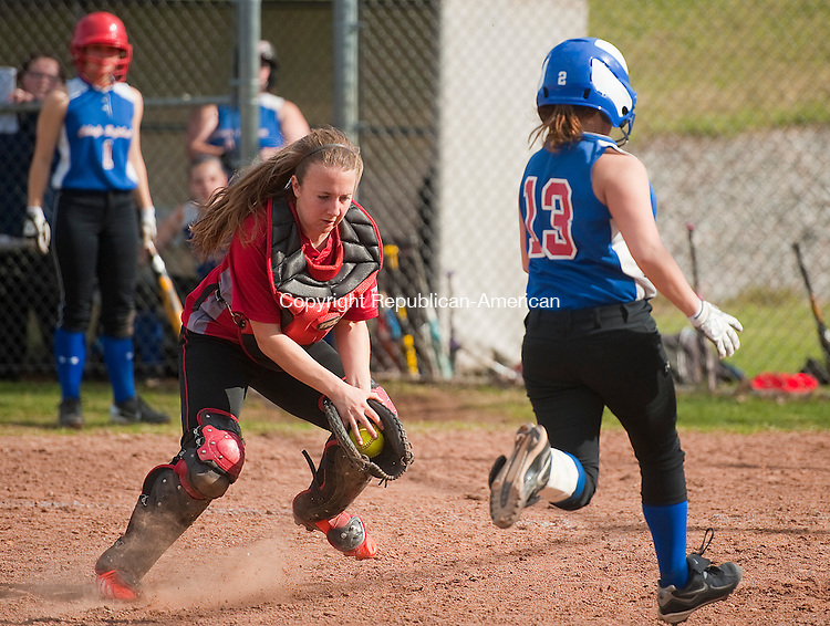 WINSTED, CT-0426014JS05- Nonnewaug's Amanda LoRusso (13), appears to score on a sacrifice fly after getting past the tag of Northwestern's Hannah Yabrosky (4), but was called out for leaving third base too early, during their game Monday at Northwestern Regional High School in Winsted. <br /> Jim Shannon Republican-American