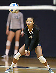 Nevada libero Kara Kasser (4) passes against Air Force during college volleyball action in Reno, Nev., on Thursday, Sept. 25, 2014. Air Force won 3-2.<br /> Photo by Cathleen Allison