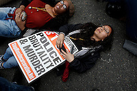 A woman lies on the street as she takes part during a protest against police brutality against minorities, 04.13.2015. in New York city Kena Betancur/VIEWpress.