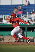 Batavia Muckdogs left fielder Albert Guaimaro (13) follows through on a swing during a game against the West Virginia Black Bears on June 19, 2018 at Dwyer Stadium in Batavia, New York.  West Virginia defeated Batavia 7-6.  (Mike Janes/Four Seam Images)