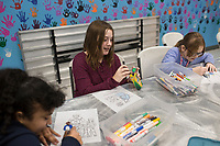 Evenees Corona, 11, (from left) Hayden Bridger, 11 and Bria Farrell, 11, color, Thursday, January 9, 2019 at the Boys and Girls Club in Bentonville.<br /> <br /> Thursday was national law enforcement appreciation day. Kids at the Boys and Girls Club made coloring sheets and wrote thank you notes to show appreciation for law enforcement. They will send some of the best ones to the Bentonville police department. Check out nwaonline.com/200110Daily/ for today's photo gallery.<br /> (NWA Democrat-Gazette/Charlie Kaijo)
