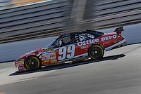 Mar 30, 2007; Martinsville, VA, USA; Nascar Nextel Cup Series driver Carl Edwards (99) during practice for the Goody's Cool Orange 500 at Martinsville Speedway. Martinsville marks the second race for the new car of tomorrow. Mandatory Credit: Mark J. Rebilas