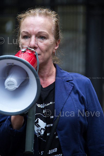 Carol Duggan (Mark Duggan's aunt, member of the Justice for Mark Duggan Campaign and member of the United Families and Friends Campaign, UFFC).<br /> <br /> London, 17/08/2014. Today, &quot;London Black Revs&quot; held a demonstration outside the US Embassy in support and solidarity with Michael Brown and the people of Ferguson, Missouri. From the organisers online press release: &lt;&lt;On Saturday 9th August 2014 Unarmed Black Man Michael Brown was shot 8 times until he died, by a police officer in Ferguson, Missouri. Since the Murder Michael Brown has been portrayed like a thug by the Mainstream Media and Ferguson PD have violently suppressed all protests, supported by some sections of the media who have branded protests &quot;Riots&quot; and labelled protesters &quot;looters&quot;. London Black Revs are calling a Solidarity Vigil outside the U.S. Embassy to call for the US to stop violently oppressing, Black People and Black Protests. We stand with the family of murdered Michael Brown, and the people of Ferguson, Missouri in their fight for Truth, Justice and Peace I their community&gt;&gt;. Speakers included, amongst others, Carol Duggan (Mark Duggan's aunt) from the Justice for Mark Duggan Campaign and from the United Families and Friends Campaign, UFFC.<br /> <br /> For more information about the organiser please click here: http://on.fb.me/1tcEips