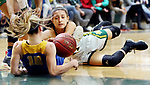 WATERBURY CT. 16 February 2018-021619SV19-#14 Maeve Perrone of Holy Cross High  and #10 Megan Condo of Seymour High battle for the loose ball during the NVL girl&rsquo;s basketball tournament in Waterbury Saturday.<br /> Steven Valenti Republican-American