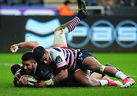 Ospreys' Rhys Webb scores his side's second try despite the attentions of Cardiff Blues&rsquo; Rey Lee-Lo<br /> <br /> Photographer Kevin Barnes/CameraSport<br /> <br /> Guinness Pro14 Round 13 - Ospreys v Cardiff Blues - Saturday 6th January 2018 - Liberty Stadium - Swansea<br /> <br /> World Copyright &copy; 2018 CameraSport. All rights reserved. 43 Linden Ave. Countesthorpe. Leicester. England. LE8 5PG - Tel: +44 (0) 116 277 4147 - admin@camerasport.com - www.camerasport.com