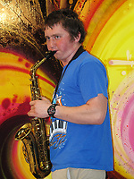Marshall Farrell plays saxophone at an Airport Muse art exhibit at the Petaluma Municipal Airport, Petaluma, Sonoma County, California