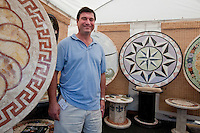 Artisan Ed DiCamargo, Stockbridge Georgia, poses with his granite designs during the 23rd Annual Downtown Naples Festival of the Arts, hosted by The von Liebig Art Association and Downtown Association, Naples, Florida, USA, March 26, 2011. Photo by Debi Pittman Wilkey