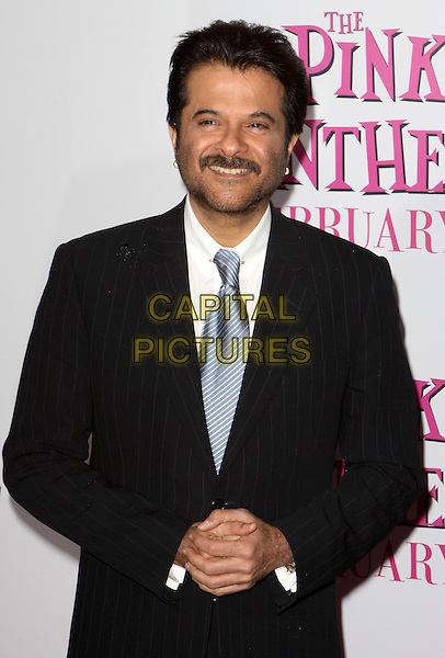 "ANIL KAPOOR.""The Pink Panther 2"" World Premiere held at the Ziegfeld Theater, New York, NY, USA..February 3rd, 2009.half length suit jacket earrings black blue tie white shirt collar stubble moustache mustache facial hair .CAP/ADM/PZ.©Paul Zimmerman/AdMedia/Capital Pictures."