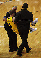 Dynamos import Eric Vierneisel is carried off with an injured ankle during the NBL Round 9 match between the Wellington Saints and Nelson Giants at TSB Bank Arena, Wellington, New Zealand on Thursday 7 May 2009. Photo: Dave Lintott / lintottphoto.co.nz