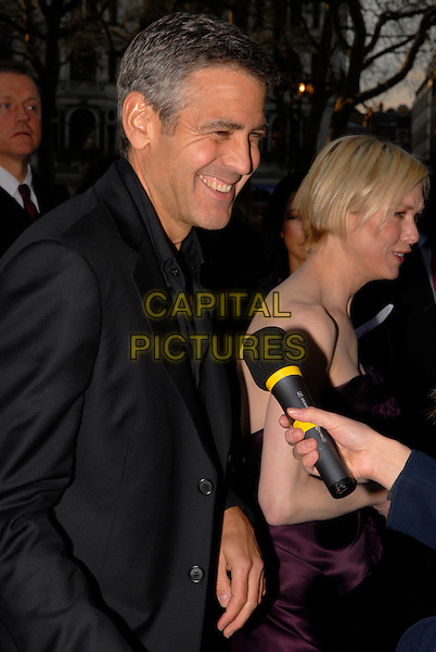 "GEORGE CLOONEY & RENEE ZELLWEGER .Attending the ""Leatherheads"" European Film Premiere held at the Odeon cinema, Leicester Square London, England, 8th April 2008..half length black jacket  microphone being interviewed .CAP/IA.©Ian Allis/Capital Pictures"