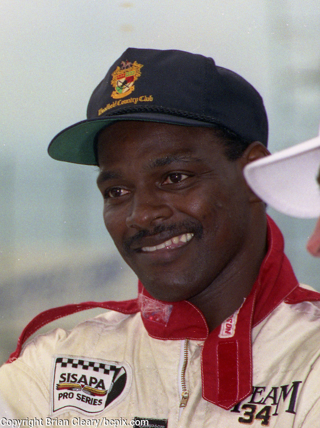 NFL Hall of Famer Walter Payton smiles before he climbs into his Renault race car at the Nissan World Challenge IMSA race, Florida State Fairgrounds, September 1990. (Photo by Brian Cleary/www.bcpix.com)