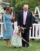 United States President Donald J. Trump and First Lady Melania Trump watch as child participates in the White House Easter Egg Roll at the White House in Washington, D.C. on April 22, 2019. <br /> Credit: Kevin Dietsch / Pool via CNP