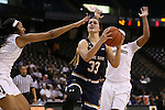 18 February 2016: Notre Dame's Kathryn Westbeld (33) and Wake Forest's Milan Quinn (left). The Wake Forest University Demon Deacons hosted the University of Notre Dame Fighting Irish at Lawrence Joel Veterans Memorial Coliseum in Winston-Salem, North Carolina in a 2015-16 NCAA Division I Women's Basketball game. Notre Dame won the game 86-52.