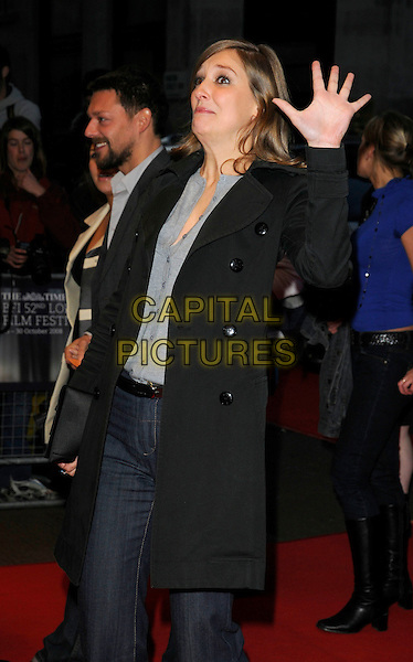 """ALEXANDRA MARIA LARA .The """"Franklyn"""" world premiere at the Times BFI London Film Festival at Odeon West End, London, England..October 16th, 2008.LFF half 3/4 length blue trousers jeans denim black coat jacket grey gray top hand palm funny .CAP/CAN.©Can Nguyen/Capital Pictures."""