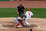 The Nationals' Jose Guillen (right) is tagged out at home by Braves' catcher Johnny Estrada in the bottom of the sixth inning on Monday, May 30, 2005. The Washington Nationals defeated the Atlanta Braves 3-2 at RFK Stadium in Washington, DC.
