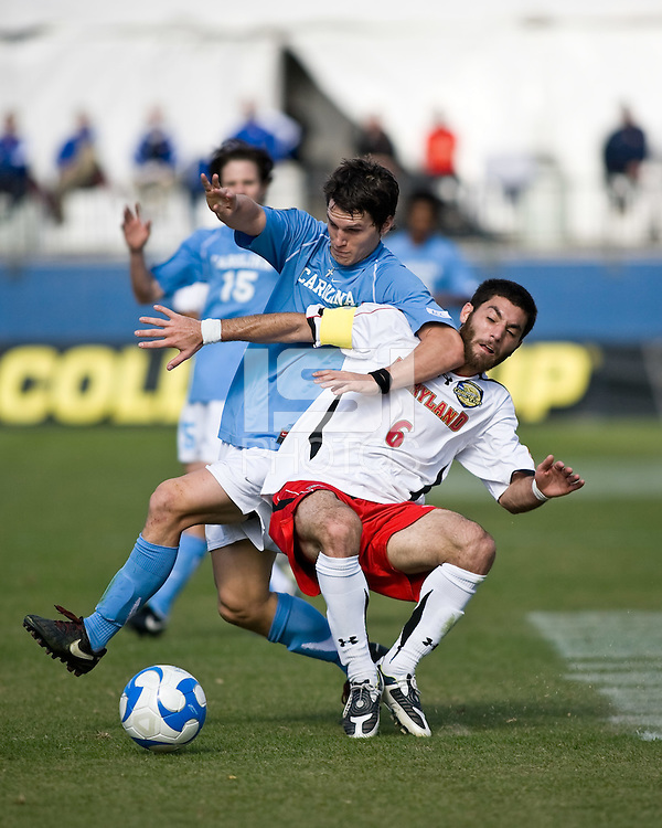 Maryland midfielder Doug Rodkey (5) and North Carolina midfielder Zach Loyd (3) battle for control of the ball.  Maryland Terrapins defeated North Carolina Tar Heels 1-0 to win the NCAA Men's College Cup at Pizza Hut Park in Frisco, TX on December 14, 2008.  Photo by Wendy Larsen/isiphotos.com