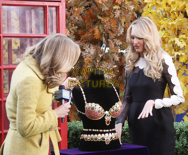 NEW YORK, NY - NOVEMBER 6: Lara Spencer &amp; Candice Swanepoel at Good Morning America promoting the new Victoria's Secret Angel Royal Fantasy Bra. New York City. November 6th, 2013 in New York, NY., USA.<br /> CAP/MPI/RW<br /> &copy;RW/ MediaPunch/Capital Pictures