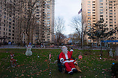New York, New York<br /> December 22, 2011<br /> <br /> Samuel Gompers Houses public housing Santa display on the Lower East Side of Manhattan has two, 20-story buildings with 474 apartments housing an estimated 1,116 residents. Completed April 30, 1964, the 3.7-acre site is between Delancey, Pitt and Stanton Streets.