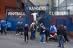 A seagull passes the gates at the Broomloan Road end of Ibrox as fans make their way into the Stadium