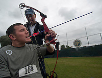 101005-N-7981E-794 SAN DIEGO (October 5, 2010)- Former Army Spc. Erik Hjeltnes learns to draw and fire a bow with his teeth from retired Army Cpl. Kevin Stone, a 2004 and 2008 Team U.S.A. Paralympic Gold Medal Winner and current world record holder, during the U.S. Olympic Committee's Paralympic Military Sports Camp hosted at Naval Medical Center San Diego. More than 60 injured service men and women from the U.S., British, and Israeli armed forces participated in the four-day event designed to introduce paralympic sport to active duty military personnel and veterans with physical injuries.  (U.S. Navy photo by Mass Communication Specialist 2nd Class James R. Evans / RELEASED)