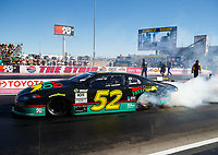 Oct 27, 2017; Las Vegas, NV, USA; NHRA pro stock driver Deric Kramer does a burnout in his Days of Thunder themed car driven by character Cole Trickle during qualifying for the Toyota National at The Strip at Las Vegas Motor Speedway. Mandatory Credit: Mark J. Rebilas-USA TODAY Sports