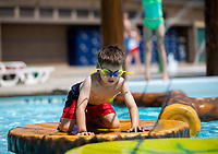 NWA Democrat-Gazette/JASON IVESTER<br /> Vince Bucalo (cq), 5, of Bentonville makes his way across floating platforms Monday, May 29, 2017, at the Rogers Aquatic Center.
