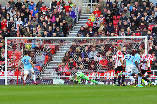 10.11.2013 Sunderland, England. Vito Mannone makes another save as he keeps a clean sheet during the Premier League game between Sunderland and Manchester City from the Stadium of Light.
