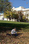 0411-07 Fall GCS..Photo by Steve Walters/BYU.Students studying in the fall leaves with Maeser in the background.
