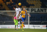 Marcus Bean of Wycombe Wanderers & Jack Thomas of Mansfield Town during the The Checkatrade Trophy  Quarter Final match between Mansfield Town and Wycombe Wanderers at the One Call Stadium, Mansfield, England on 24 January 2017. Photo by Andy Rowland.