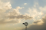Lone Aermotor windmill, gathering afternoon storm, New Mexico.
