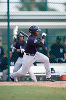New York Yankees Isiah Gilliam (25) follows through on a swing during an Instructional League game against the Pittsburgh Pirates on September 28, 2017 at Pirate City in Bradenton, Florida.  (Mike Janes/Four Seam Images)