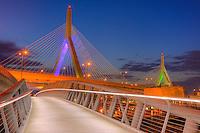 The sky begins to lighten during morning twilight behind the Leonard P. Zakim Bunker Hill Memorial Bridge.  The bridge carries I-93 and US Route 1 traffic over the Charles River in Boston, Massachusetts.