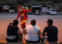 Fariseo vestido de el Chapulin Colorado, Chespirito. Fariseos con mascaras deminiacas y disfraces alinigenas y demonios, durante la celebraciones de cuaresma, Semana Santa en la colonia Coloso Alto...<br /> Pharisee dressed in the Colorado Chapulin, Chespirito. Pharisees with deminiacal masks and aliigeni disguises and demons, during the celebrations of Lent, Holy Week in the Colossus Colony ...<br /> (Photo:Luis Gutierrez/NortePhoto)