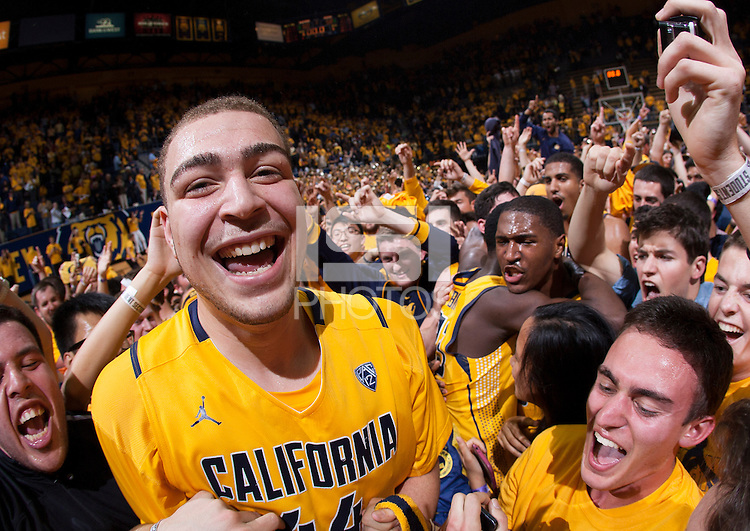 Kameron Rooks of California celebrates with the fans after winning the game against Arizona at Haas Pavilion in Berkeley, California on February 1st, 2014.  California Golden Bears defeated Arizona Wildcats, 60-58.