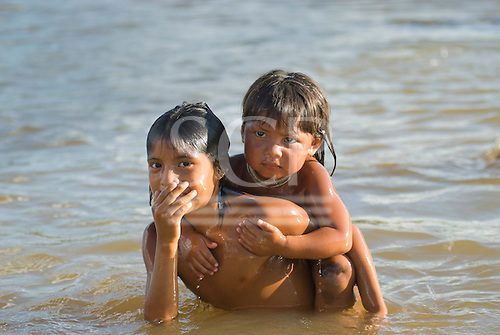 Xingu Indigenous Park, Mato Grosso State, Brazil. Aldeia Afukuri (Kuikuro). Children washing in the river.