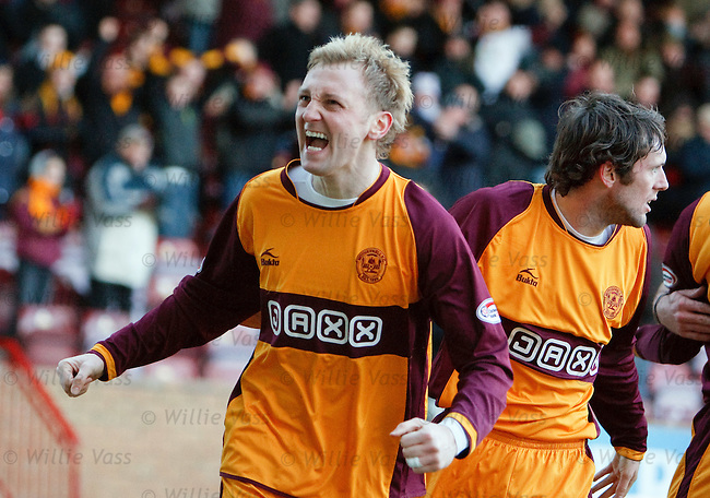 Stephen Hughes roars his delight after equalising for Motherwell