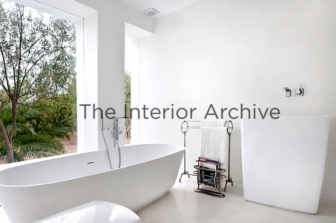 A wall was knocked down in the bathroom and replaced with a picture window which looks out onto a private orchard