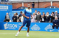 13.06.13 London, England. Jo-Wilfried Tsonga celebrates after beating Edouard Roger-Vasselin during the The Aegon Championships from the The Queen's Club in West Kensington.