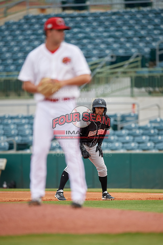 Jupiter Hammerheads Victor Victor Mesa (32) leads off first base as pitcher Keith Weisenberg gets ready to deliver a pitch during a Florida State League game against the Florida Fire Frogs on April 8, 2019 at Osceola County Stadium in Kissimmee, Florida.  Florida defeated Jupiter 7-6 in ten innings.  (Mike Janes/Four Seam Images)
