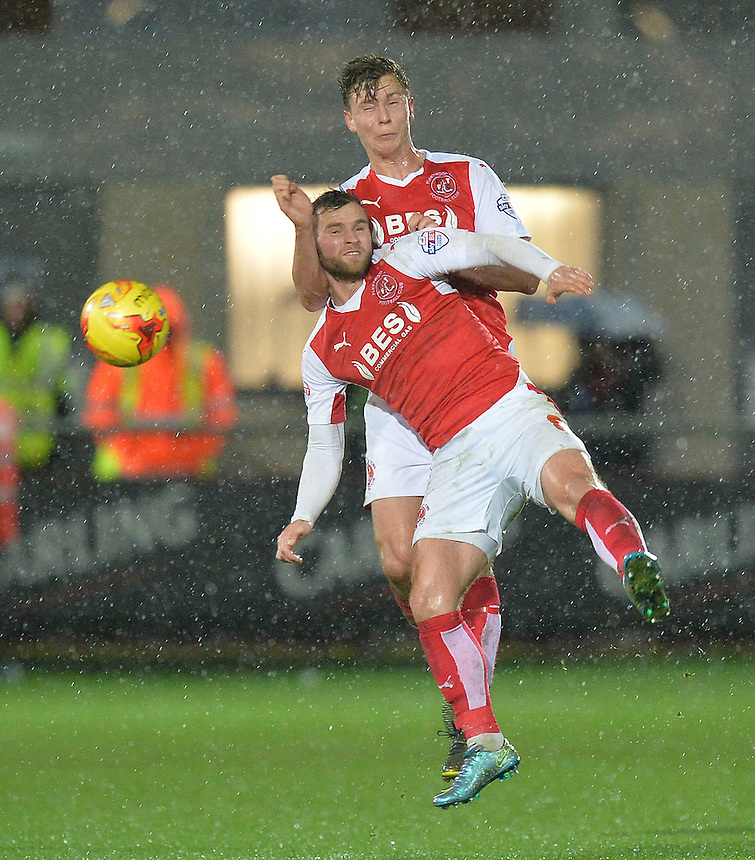 Fleetwood Town's Eggert Jonsson and Jimmy Ryan both go for the ball<br /> <br /> Photographer Dave Howarth/CameraSport<br /> <br /> Football - The Football League Sky Bet League One - Fleetwood Town v Millwall - Tuesday 24th November 2015 - Highbury Stadium<br /> <br /> &copy; CameraSport - 43 Linden Ave. Countesthorpe. Leicester. England. LE8 5PG - Tel: +44 (0) 116 277 4147 - admin@camerasport.com - www.camerasport.com