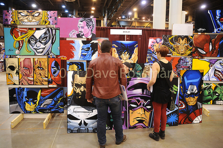 Guests look at colorful artwork by Jett at Space City Comic Con at NRG Center Saturday May 28,2016(Dave Rossman Photo)