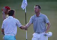 Michael Hoey (NIR) shakes hands with Eddie Pepperell (ENG) after a successful card of 65(-10) during Round Two of The Tshwane Open 2014 at the Els (Copperleaf) Golf Club, City of Tshwane, Pretoria, South Africa. Picture:  David Lloyd / www.golffile.ie